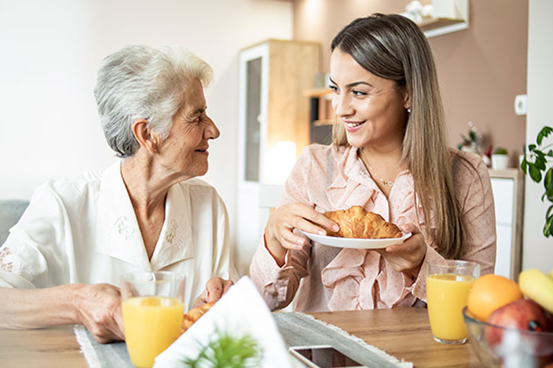 caregiver-assisting-with-seniors-daily-routine
